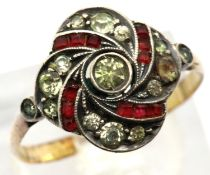 Yellow metal ring set with red and white stones. 2.6g. size Z. P&P group 1 (£14 for the first lot