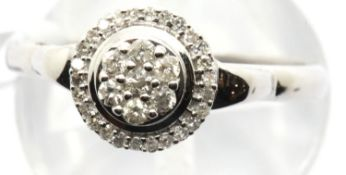 9ct white gold diamond halo ring, size O, 1.6g. Condition report: attached tag says made in India,