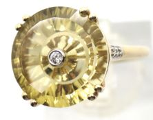 9ct yellow gold ring with a small diamond set in a large citrine? Size N, 3.2g. Condition report: