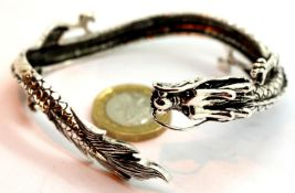 925 Tibetan silver dragon bangle. P&P Group 1 (£14+VAT for the first lot and £1+VAT for subsequent