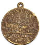 Worn brass McCormick medal. P&P Group 1 (£14+VAT for the first lot and £1+VAT for subsequent lots)