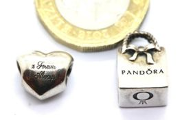 Two genuine Pandora sterling silver charms stamped ALE. P&P Group 1 (£14+VAT for the first lot