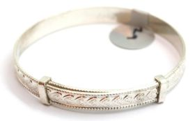 Silver vintage heart engraved adjustable baby bangle, stamped 925. P&P Group 1 (£14+VAT for the
