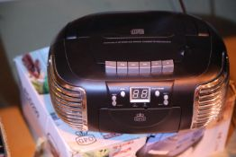 Black 3 in 1 FM/AM radio, CD and cassette player, boxed, GPOPCD299. P&P Group 2 (£18+VAT for the