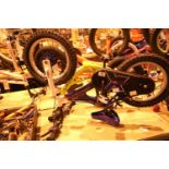 "Boys Tineo (Pinnacle) balance bike and a Raleigh (RaceMX) single speed 10"" framed bike. Not"