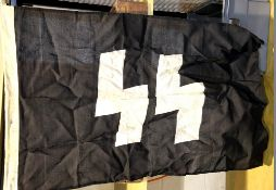 German WWII type SS flag bearing stamps and dated 1942, 90 x 60 cm. P&P Group 1 (£14+VAT for the