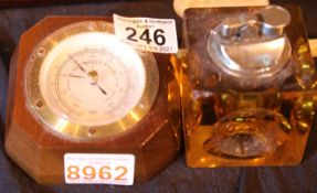 Cased barometer and resin encased cigarette lighter. P&P Group 2 (£18+VAT for the first lot and £3+