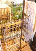 Two chrome extending shoe racks, metal shoe rack and a metal framed coat stand. Not available for