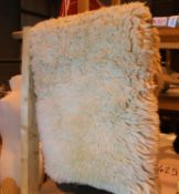 Sheepskin rug, L: 95 cm. Not available for in-house P&P, contact Paul O'Hea at Mailboxes on 01925