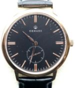 New boxed Ornake gents wristwatch with Japanese Mituyo movement and gold with black face. P&P