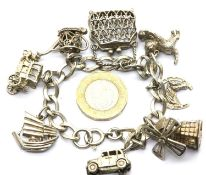 Silver charm bracelet with 8 charms, 44g. P&P Group 1 (£14+VAT for the first lot and £1+VAT for