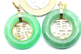 Two 14ct gold and jade pendants, largest D: 25 mm, total 9.1g. P&P Group 1 (£14+VAT for the first