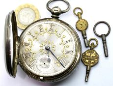 Hallmarked silver pocket watch, London assay with ornate silver dial and vintage watch keys, not