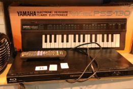 Yamaha PSS-130 electric keyboard and a Panasonic Blu-ray player with remote. P&P Group 2 (£18+VAT