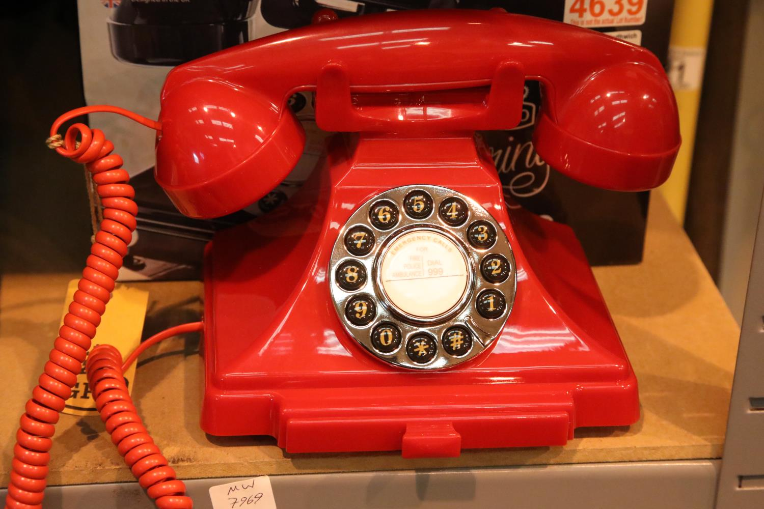 Red GPO Carrington, push button telephone in 1920s styling with pull-out pad tray; compatible with