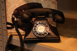The GPO 200 rotary telephone has a metal base and handset; traditional cloth curly cord; is
