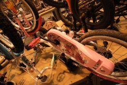 """B-Twin pink child's bike with 16"""" wheels and a Voodoo child's balance bike. Not available for in-"""