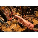 "B-Twin pink child's bike with 16"" wheels and a Voodoo child's balance bike. Not available for in-"
