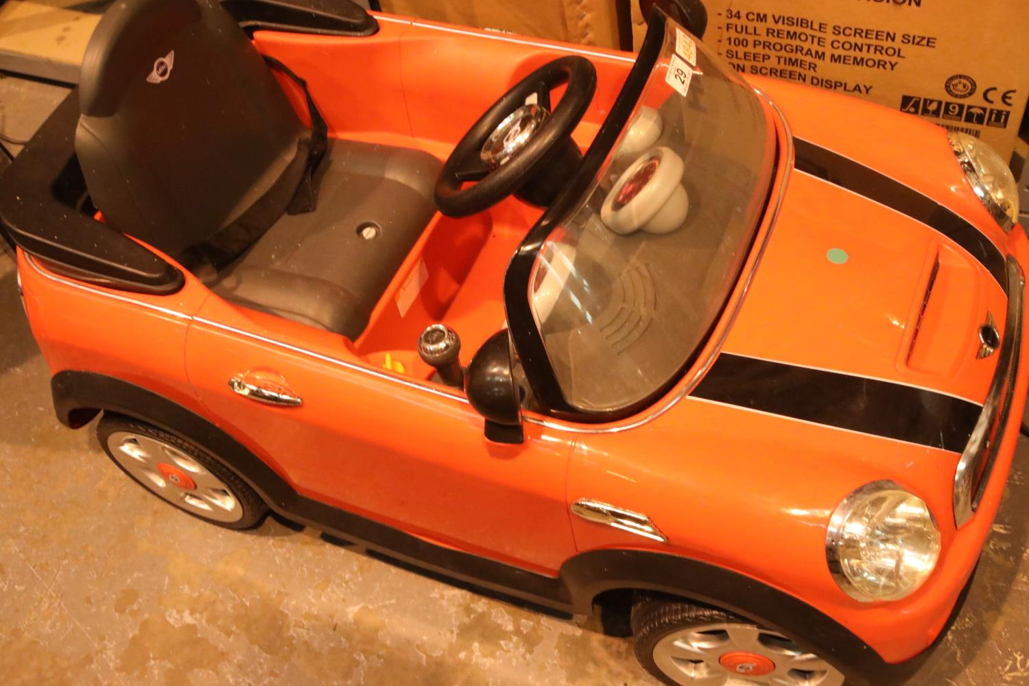 Child's electric Mini Cooper with charger. Not available for in-house P&P, contact Paul O'Hea at