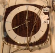 1970's chain driven wall clock, lacking weights and pendulum, not working at time of lotting, dial