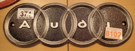 Cast iron Audi sign, 30 x 11 cm. P&P Group 1 (£14+VAT for the first lot and £1+VAT for subsequent