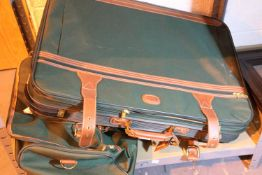 Two large travel suitcases. Not available for in-house P&P, contact Paul O'Hea at Mailboxes on 01925