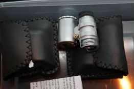 Two new old stock cased 60x currency/jewellery detecting loupes with LED light. P&P Group 1 (£14+VAT
