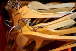 Box of approximately 20 wood coat hangers. Not available for in-house P&P, contact Paul O'Hea at