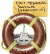 Imperial German Kriegsmarine memorial souvenir leather bound frame in the form of a buoyancy aid,