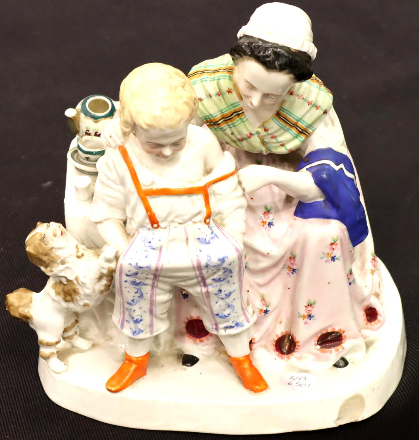 Continental woman and boy figurine, H: 21 cm. P&P Group 2 (£18+VAT for the first lot and £3+VAT