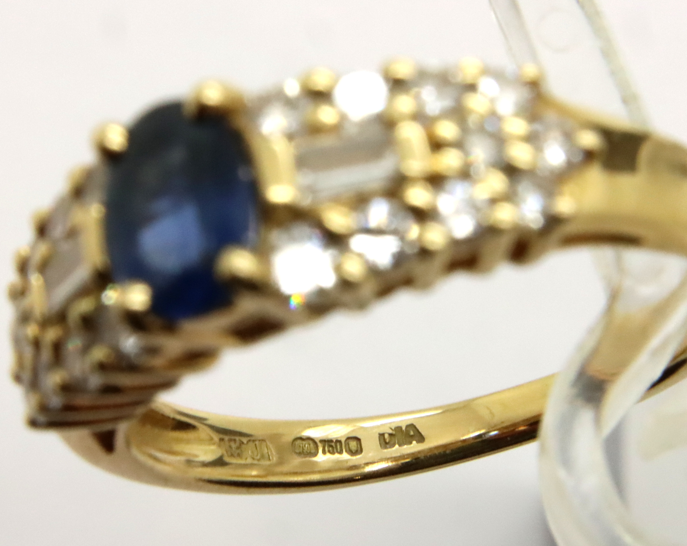 A Contemporary 18ct gold Sapphire and Diamond set cocktail ring, the single central oval sapphire of - Image 2 of 2