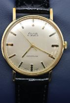 Avia vintage mechanical 9ct gold wristwatch on black leather strap, working at lotting with original