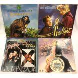 Four laser discs 1990s; Gaslight, National Velvet, Mutiny on The Bounty and The Killer. P&P Group