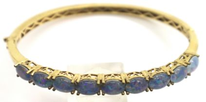 Yellow metal stone set snap bangle marked Karis, 12g. P&P Group 1 (£14+VAT for the first lot and £
