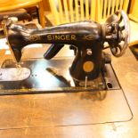 Treadle singer sewing machine with metal frame support changed to electricity. Not available for