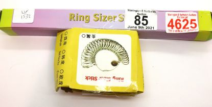 New and boxed ring sizer stick and a set of metal ring sizer gauges. P&P Group 1 (£14+VAT for the