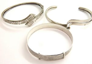 Three silver bangles, 37g. P&P Group 1 (£14+VAT for the first lot and £1+VAT for subsequent lots)