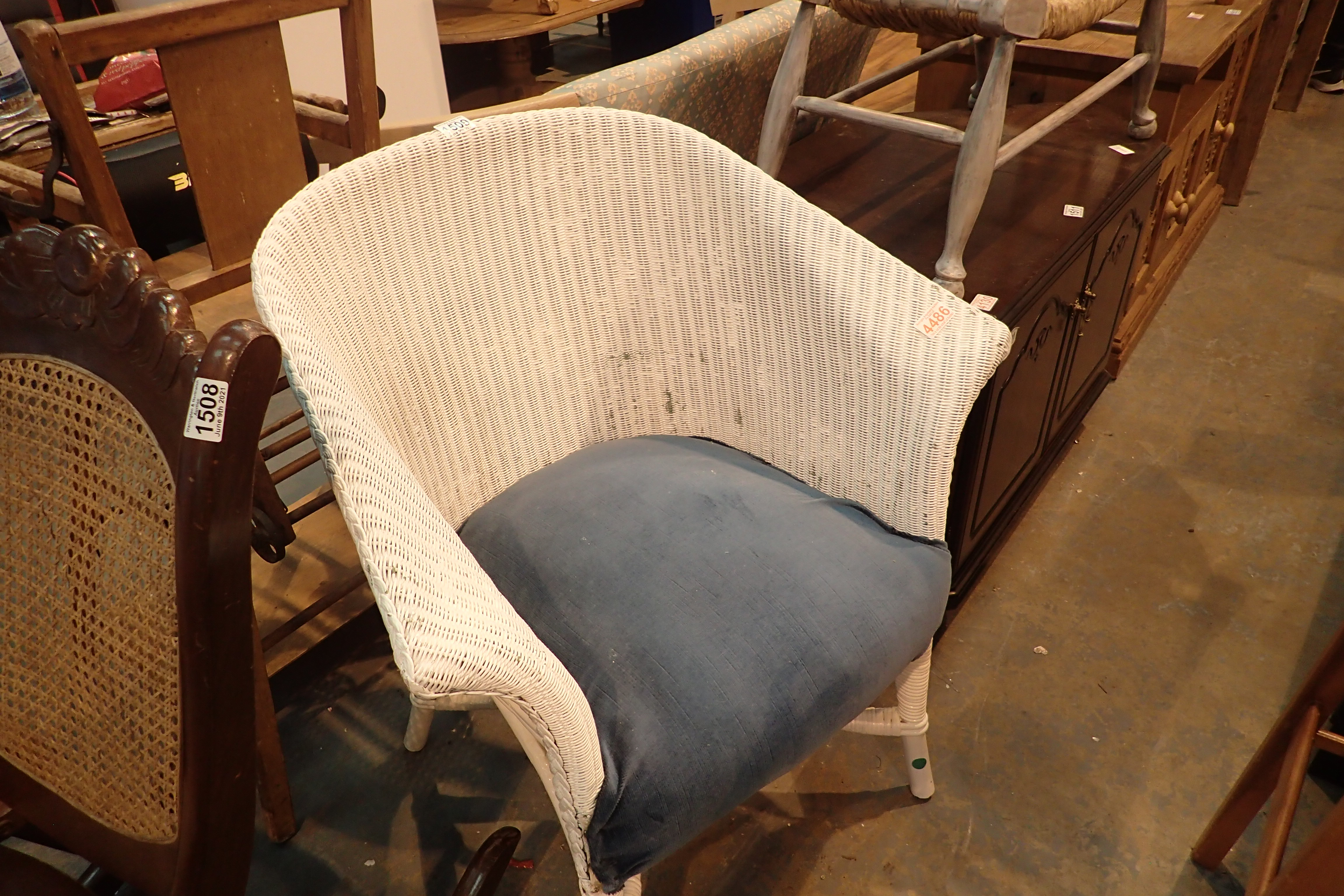 Lloyd loom style chair. Not available for in-house P&P, contact Paul O'Hea at Mailboxes on 01925