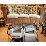 Cane conservatory three seat settee along with two wingback armchairs, one electrical. Not available