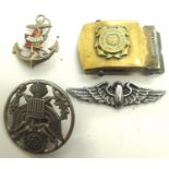 US and Canadian military badges and a US Coast Guard belt buckle in brass. P&P Group 1 (£14+VAT
