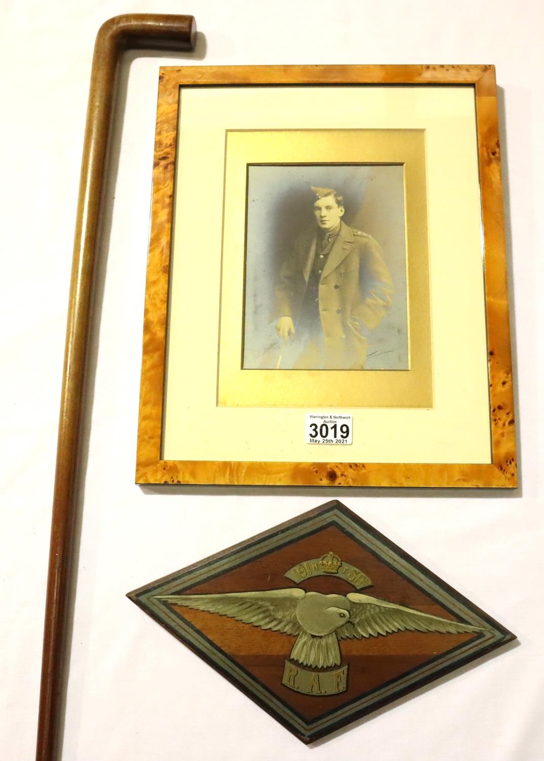 Lt. Griffiths, 191 Squadron RAF, a painted mess plaque, a later framed portrait and walking cane