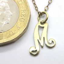 14ct gold letter M pendant on a 12ct gold chain, combined 1.3g. P&P Group 1 (£14+VAT for the first
