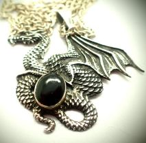 Silver dragon pendant with black onyx on a silver chain. P&P Group 1 (£14+VAT for the first lot