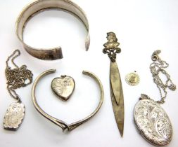 Three hallmarked silver locket pendants, two bangles and a silver plate book/page marker. P&P