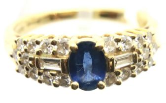 A Contemporary 18ct gold sapphire and diamond set cocktail ring, the single central oval sapphire of