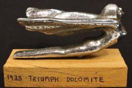 Car bonnet mascot; 1938 Triumph Dolomite, L: 12 cm. P&P Group 1 (£14+VAT for the first lot and £1+