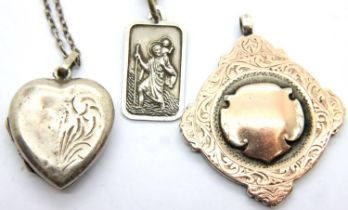 925 silver St Christopher pendant necklace, a vintage heart locket and a gold washed silver fob,