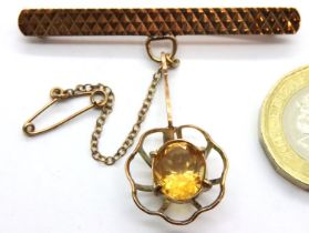 9ct gold bar brooch with cage set citrine solitaire, 5.9g. P&P Group 1 (£14+VAT for the first lot
