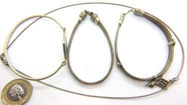 Three silver bracelets and a silver necklace, combined 39g. P&P Group 1 (£14+VAT for the first lot
