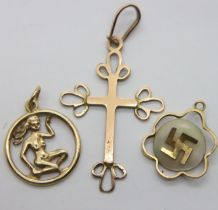 9ct gold cross, charm and lucky Swastika, combined 2.6g. P&P Group 1 (£14+VAT for the first lot